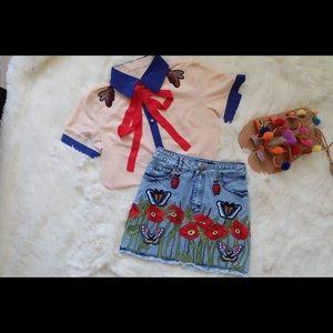 Gucci embroiled shirt and denim skirt set